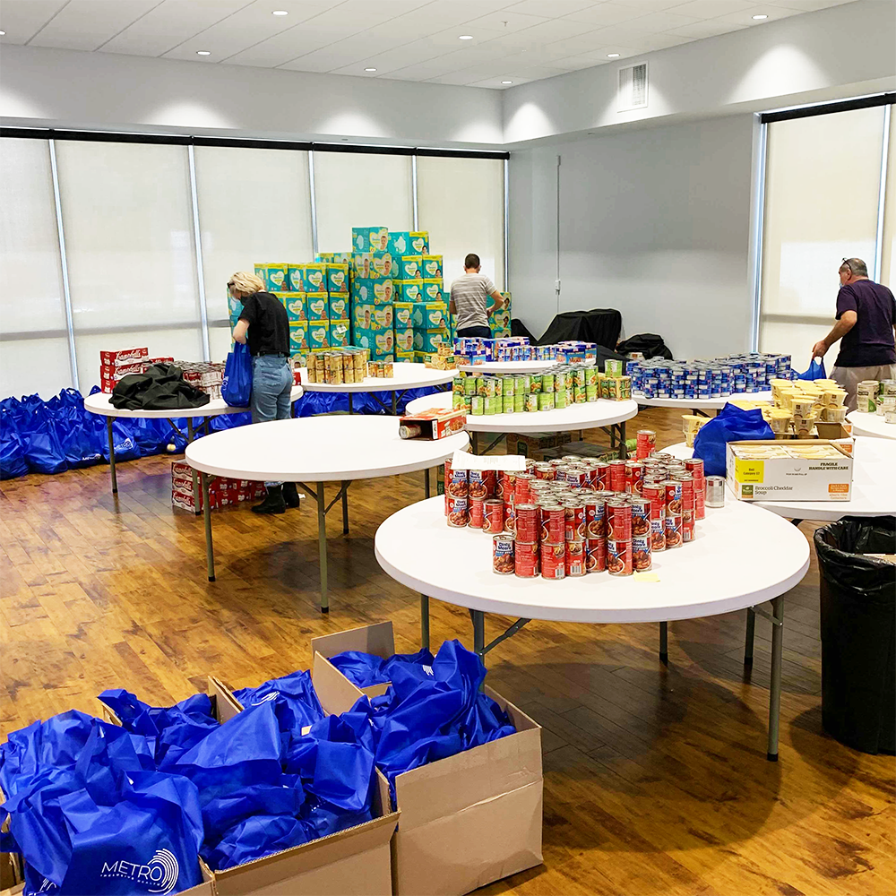 METRO Volunteers pack food bags for Tampa Bay clients in need of basic pantry items.