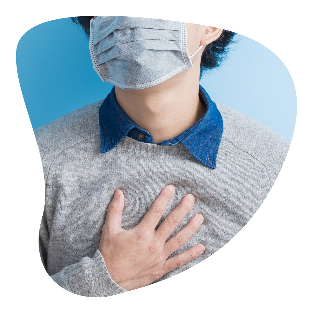 Do I have anxiety? | A person touches their chest. A common symptom of anxiety is heart pain or palpitations.