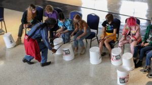 Teens started slowly then warmed up to an energetic bucket-drumming session, a way to get them working together during a week-long LGBTQ+ camp at Allendale United Methodist Church in St. Petersburg.